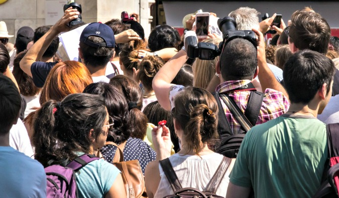 People taking photo of the Mona Lisa