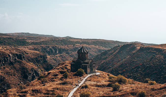 aerial view of a church in the mountains in Armenia