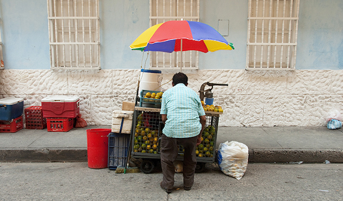 a street food vendor in Colombia selling fruit