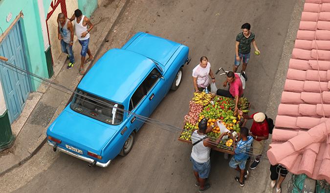 vendors selling fruit on a street in Havana