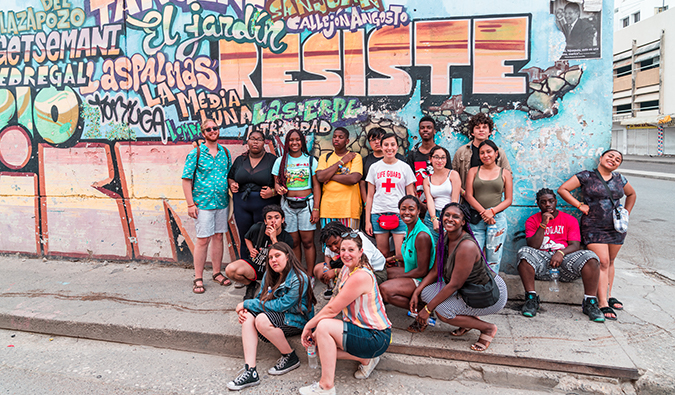 the FLYTE students enjoying a street art tour in Colombia