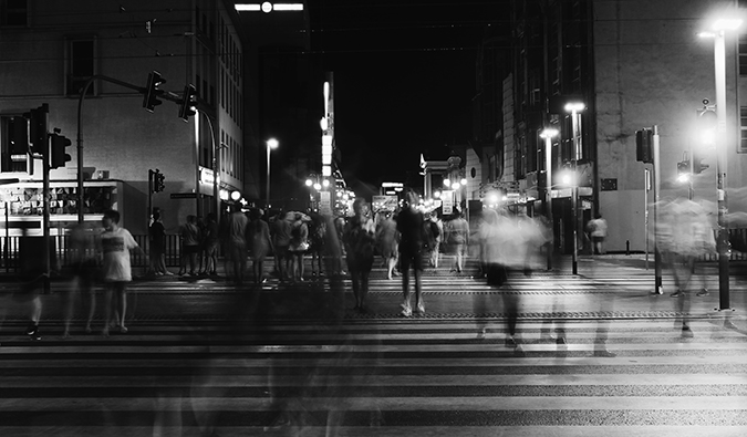 black and white photo of a busy crosswalk with blurred people