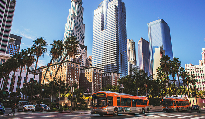 a street scene with a bus in Los Angeles