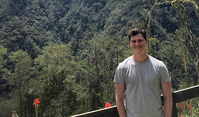 Matt Kepnes posing in front of a mountain in Colombia