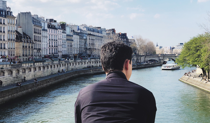 Matt Kepnes of Nomadic Matt looking over a canal in Paris