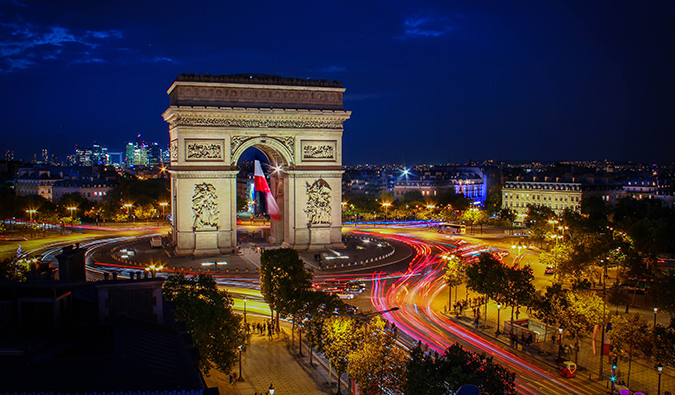 The Arc de Triomphe lit up in the evening, in Paris