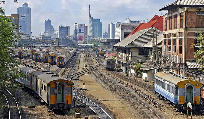 a busy train yard in Bangkok, Thailand