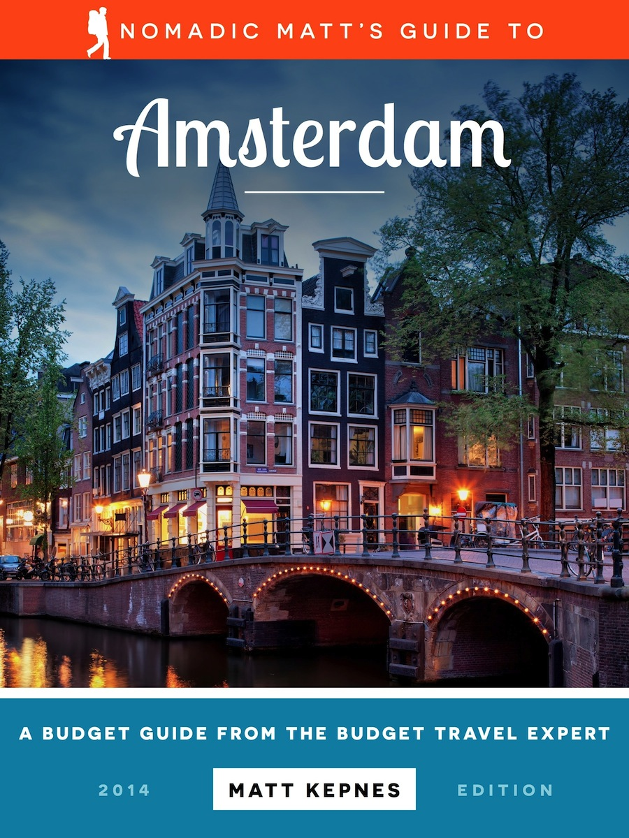 The cover of the amsterdam travel guide by nomadic matt