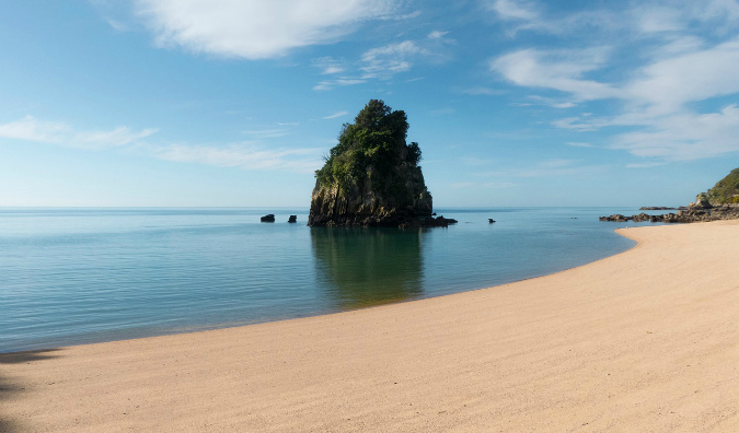 An empty beach and clear water in Abel Tasman National Park