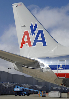 The tail and logo of an American Airlines airplane