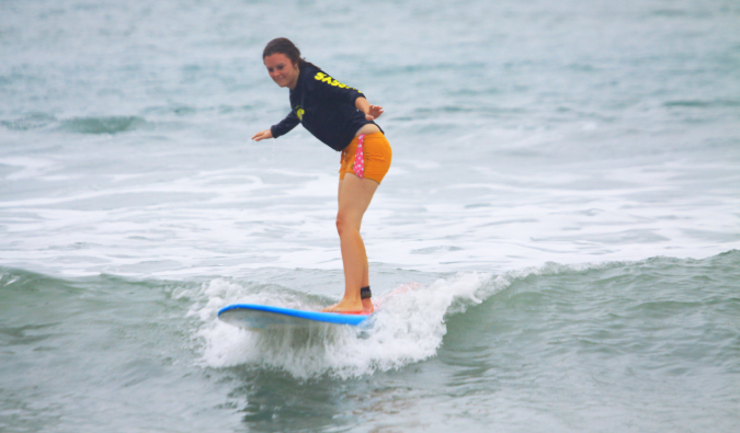 Solo female traveler learning to surf in Bali Indonesia