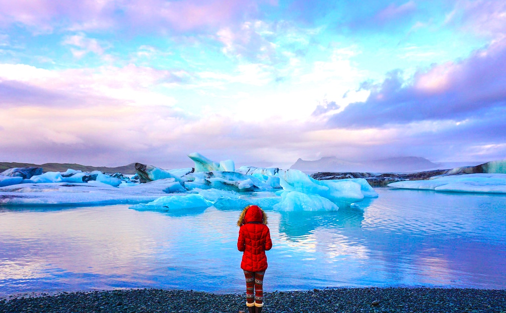 girl with amazing glaciers in iceland
