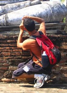 Nomadic Matt taking a photo while overseas