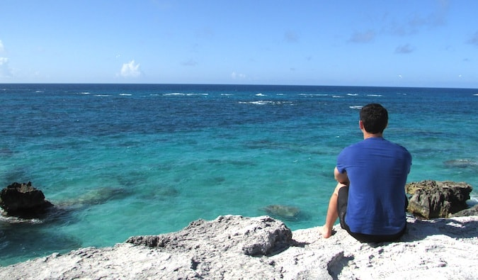 Nomadic Matt looking out onto the clear blue water in Bermuda
