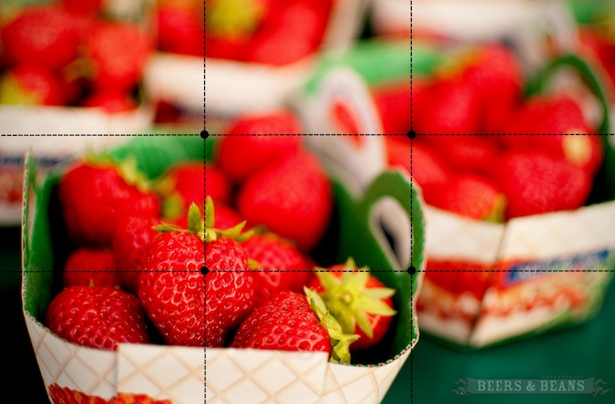 Box of red strawberries using the photography tip: rule of thirds