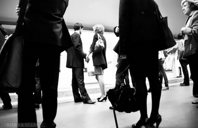Black and while photo of people waiting for the subway overseas