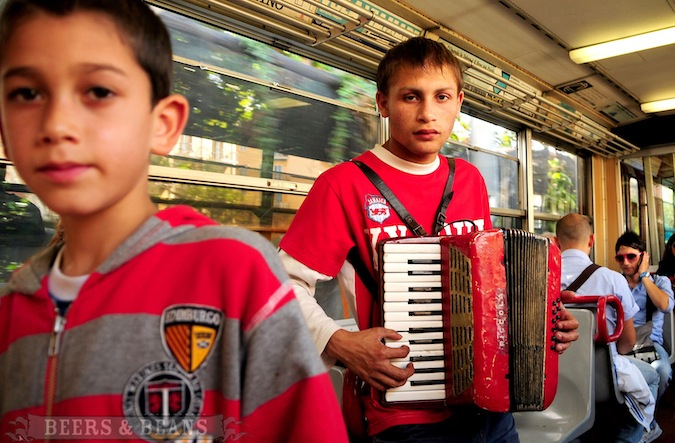 Sad Italian boys playing instruments on the bus in Sorrento