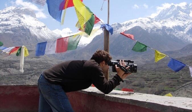 Brook Silva-Braga filming near mountains