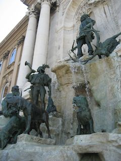 A hunting statue in Budapest on a nice day