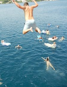 jumping off the busabout boat in croatia