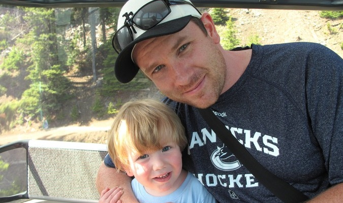 Cameron of Traveling Canucks posed with his son overseas