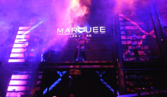 Marquee Las Vegas sign surrounded by the fog and purple strobe lights in the club