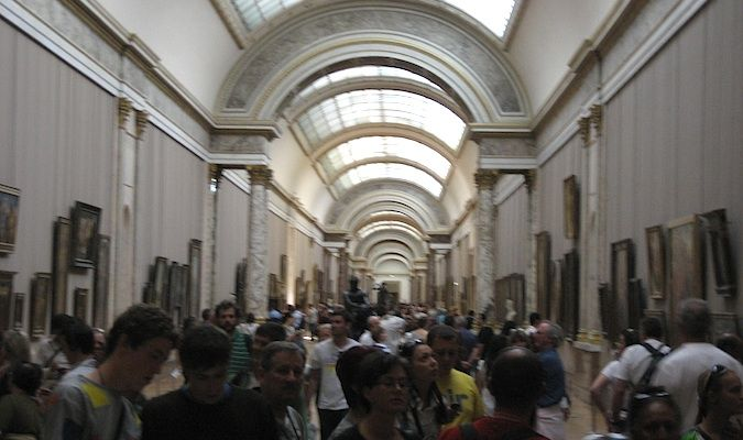 The museum crowds and tourists packed into the Louvre, Paris, France