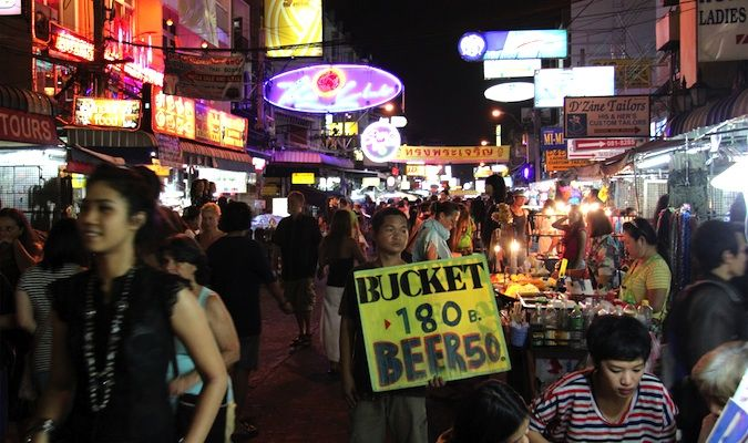 Crowded tourist travelers on Khao San Road in Bangkok, Thailand