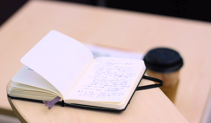 an ope notebook on a desk, photo by @waferboard (flickr)