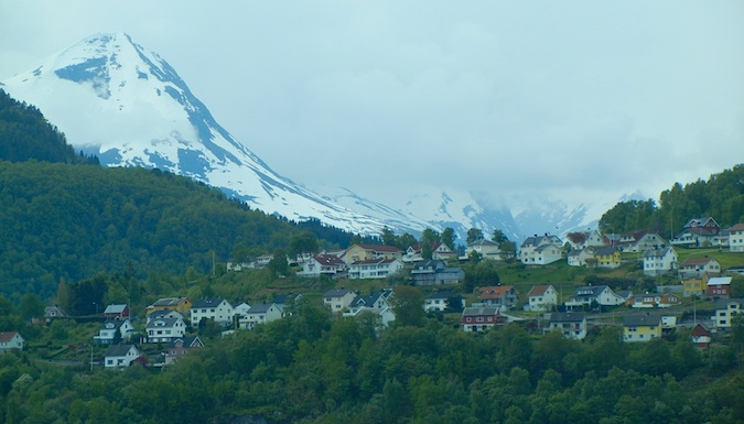 Some town in the Fjord with a snow-capped mountain overhead