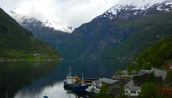 A boat in the water around Geiranger town