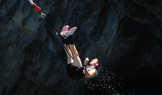 Steve Kamb bungee jumping during travels