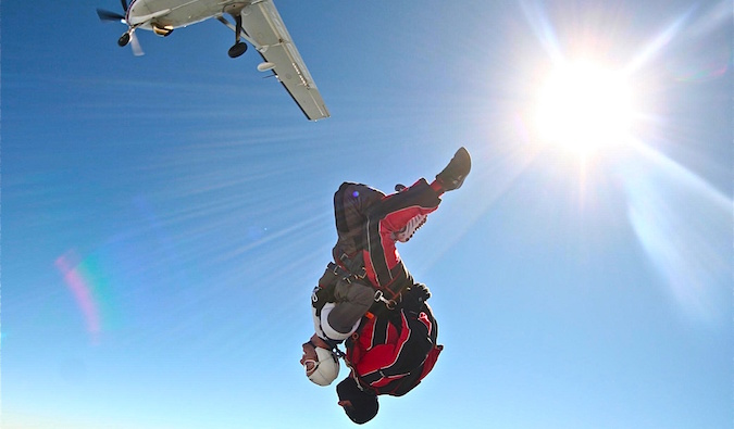 Jumping out of a plane on a skydiving adventure with a partner