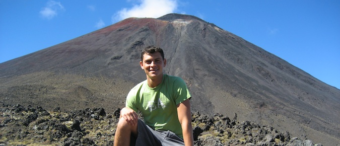 Matt Kepnes, aka Nomadic Matt, sitting at the fool of a volcano