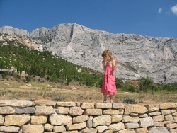 The Future is Red Family daughter walking on a wall overseas