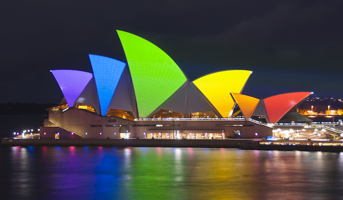 sydney opera house decorated in rainbow colors to celebrate gay pride