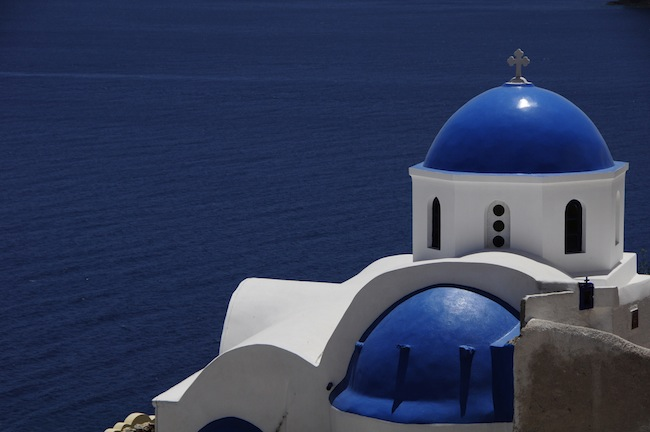 The blue roofs on the island of Santorini which is famous for its volcano and Caldera