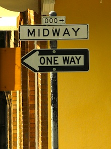 A street sign depicting being at the midpoint, halfway home