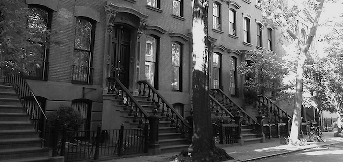 Black and white photo of town houses in NYC, my non-nomadic home