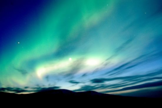 The blues and greens of the sky while visiting the Icelandic Northern Lights