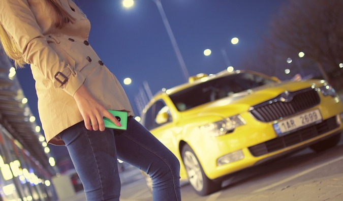 Girl with phone waiting for taxi