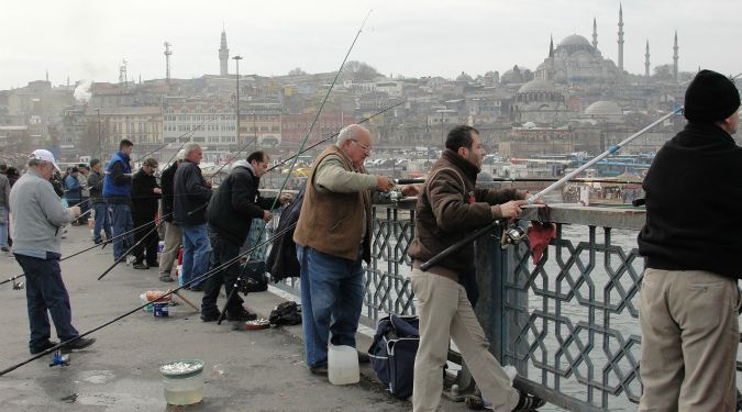 Lots of fisherman on Galata Bridge in Turkey on a cold day