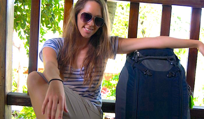 kristin addis, female solo travel expert, with her well-packed suitcase