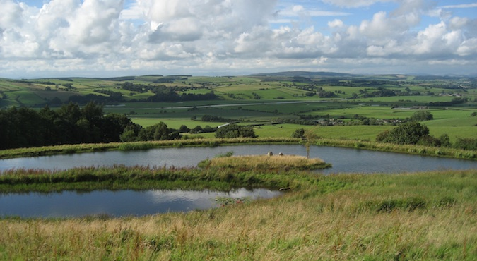 Picturesque view of the lake and rolling hills on a sunny day in northern England