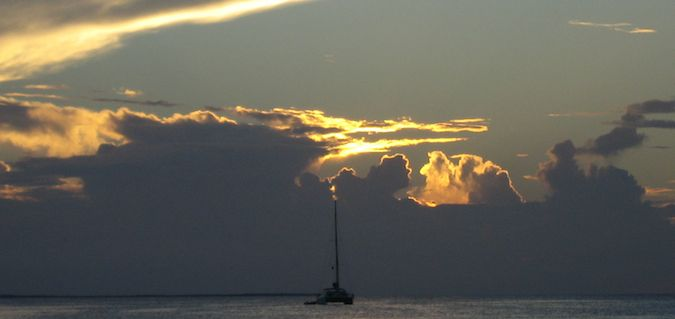sailing into the sunset in belize