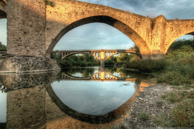 Photo of old bridges in the Medieval town of Besalú, Spain