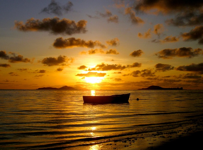 Stunning travel photo of a boat in the sunset