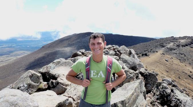 Nomadic Matt hiking with backpack