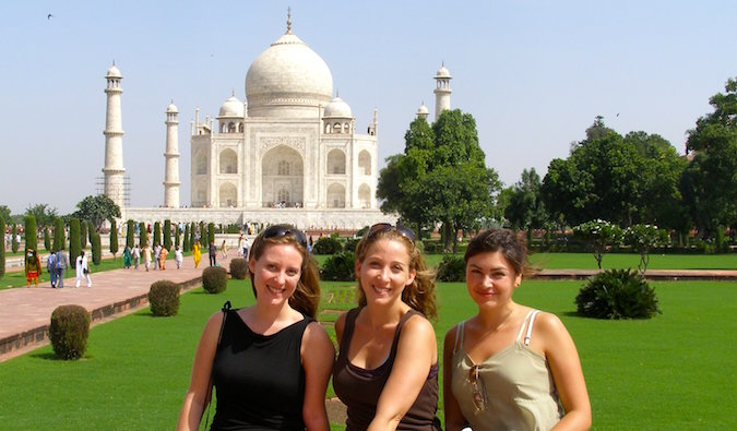 the lost girls in front of the taj mahal in india