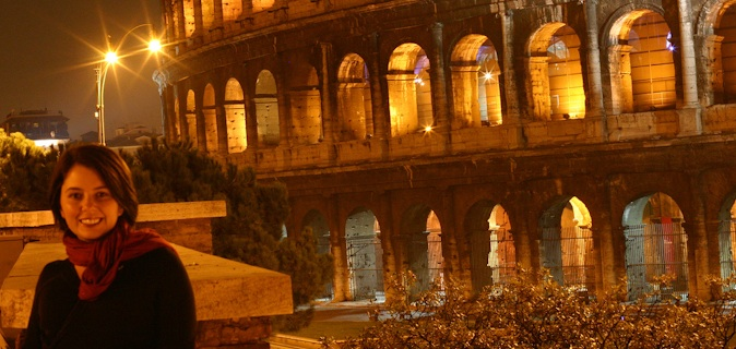 Girl (Ayngelina) in Rome in from of the Colosseum at night with the light shining brightly